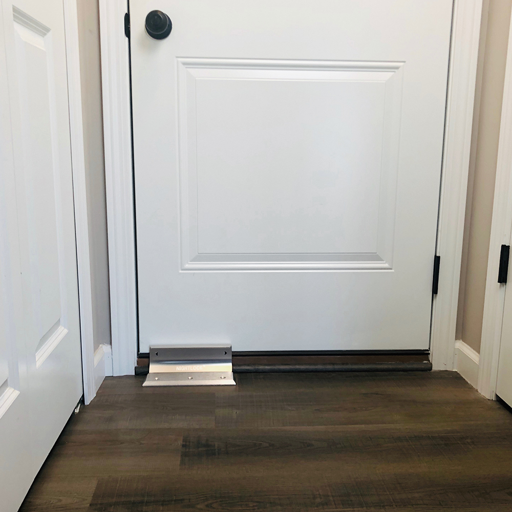 Night lock put in place of a white door on hardwood